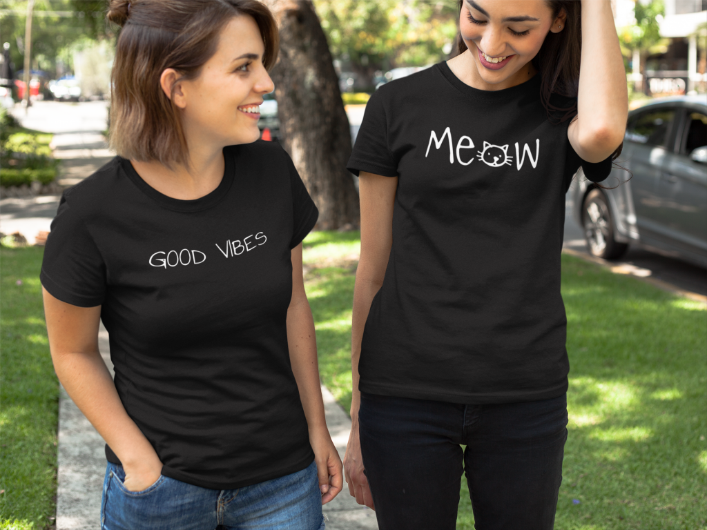 Women wearing Good Vibes and Meow t-shirts