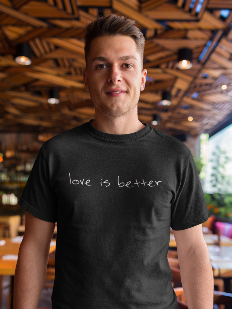 Man wearing love is better t-shirt